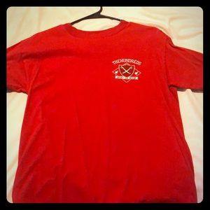 The hundreds red shirt with design on the back